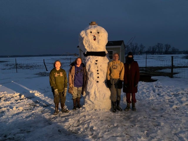 Pictured from the left are: Macie Maxwell, Mara Maxwell, Mr. Snowman, Nevaeh Howard, and Gianna Stevens.
