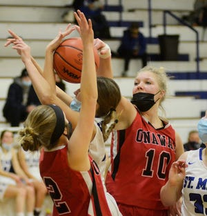 Onaway's Breya Domke (10) and Nicole Larson (2) defend a Gaylord St. Mary's player during a recent Ski Valley matchup. Domke and Larson helped the Cardinals improve to 3-3 overall after a home victory over Central Lake on Monday.