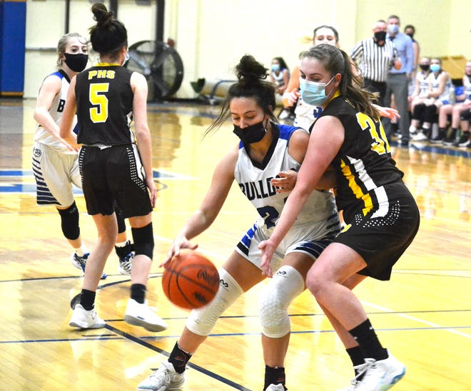 Inland Lakes sophomore forward Ryann Clancy (left) posts up on Pellston senior Madison Hutchinson during the first half of a varsity girls basketball matchup in Indian River on Monday.