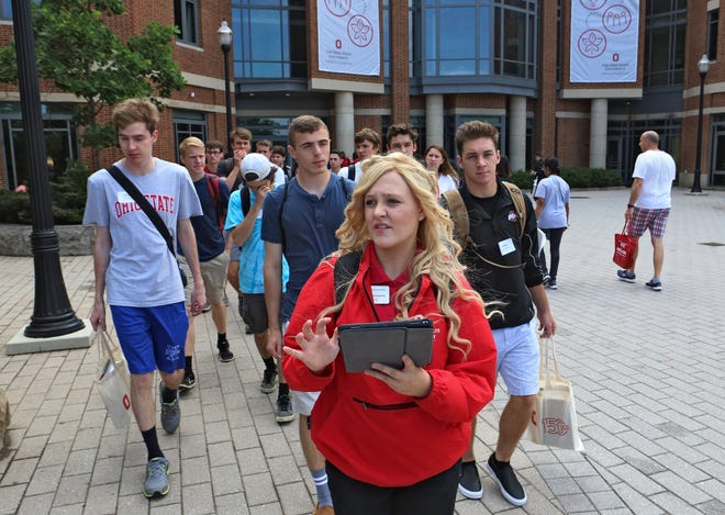 Ohio State freshmen take part in an orientation campus tour in 2018. But orientation seems far away right now, as high school seniors are waiting to hear which colleges will offer them admission.