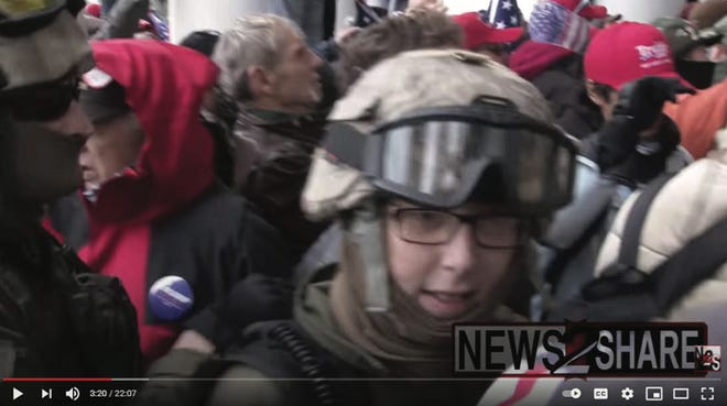 Federal investigators say this image shows Jessica Watkins, of Champaign County, at the Jan. 6 insurrection at the U.S. Capitol.  The photo was included in a federal court filing, but taken by Ford Fischer/ News2Share