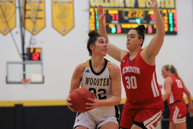 Wooster's Maria Janasko goes up against Denison. Janasko had 15 points and 11 rebounds.