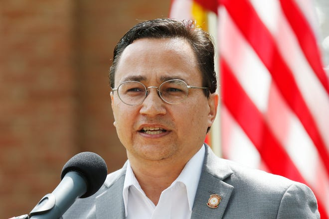 In this Aug. 22, 2019, file photo, Cherokee Nation Principal Chief Chuck Hoskin Jr., speaks during a news conference in Tahlequah, Okla. The chief of the Cherokee Nation says it's time for auto maker Jeep to stop using the tribe's name on its Cherokee and Grand Cherokee models.