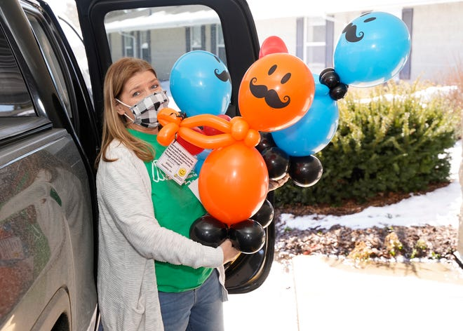 Michelle Miller, of Masquerades by Michelle, delivers Balloon Buddies Tuesday to the residents of The Oasis at Adrian Rehabilitation and Healthcare Center. Miller's Balloon Buddies are a way for the community to let senior citizens know they aren't forgotten about during the pandemic.