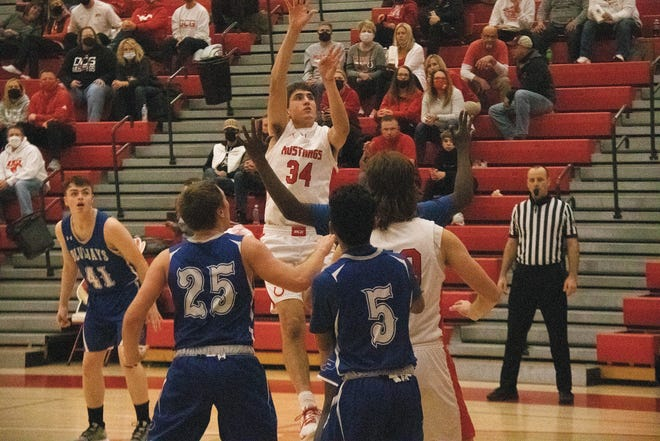DCG's Brayden Fuller goes up for a basket during the substate opening round against Perry on Monday, Feb. 22 in Grimes.