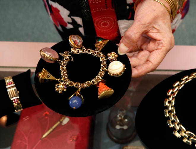 Chris Evans, of Evans & Son Fine Jewelers, displays one of the shop's hand-picked antique bracelets, part of an inventory that features period pieces gathered from around the world. The shop opened in Daytona Beach in 1975 and has been in its Beach Street location since 1983.