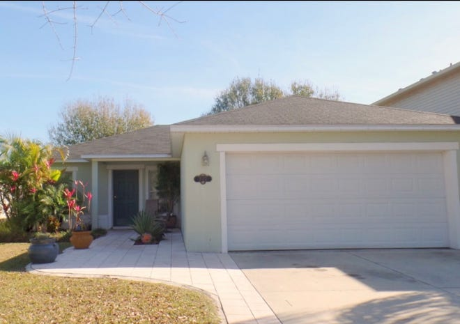 This lovely three-bedroom, two-bath, two-car-garage block home overlooks a lake in a great New Smyrna Beach neighborhood.