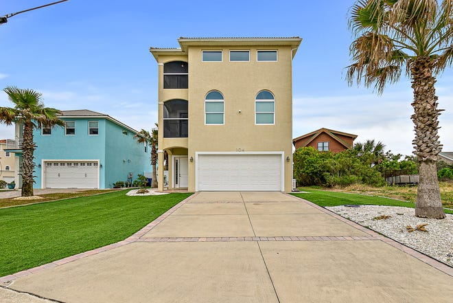 Custom built in 2012, this gorgeous Ormond Beach home's beachy and comfortable flow maximizes indoor/outdoor living, rivaling five-star resorts.