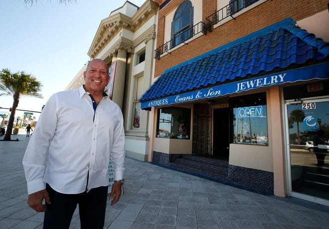 Allan Brewer, of Evans & Son Fine Jewelers, surveys the scene on Beach Street in front of his shop, a fixture in Daytona Beach for decades. In the wake of the city's $4 million streetscape project on Beach Street and the reopening of the Orange Avenue bridge after its $47 million renovation, Brewer said that he is seeing more locals in the shop.