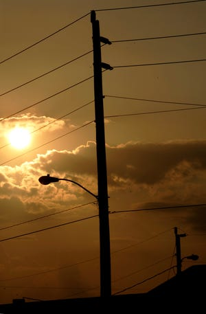 Power lines in Flagler Beach are linked to an electrical grid that powers Florida using a variety of sources, including solar energy.