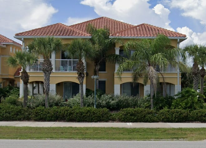 This very-well-maintained, three-bedroom, three-bath townhome is just one block down a path to the beach.