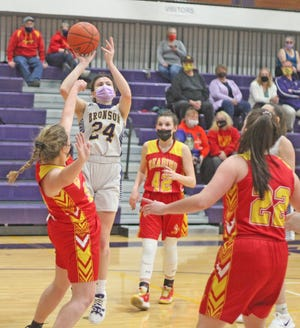 Bronson's Jenna Salek (24) rises above the defense for two points in the Vikings win over Reading Monday
