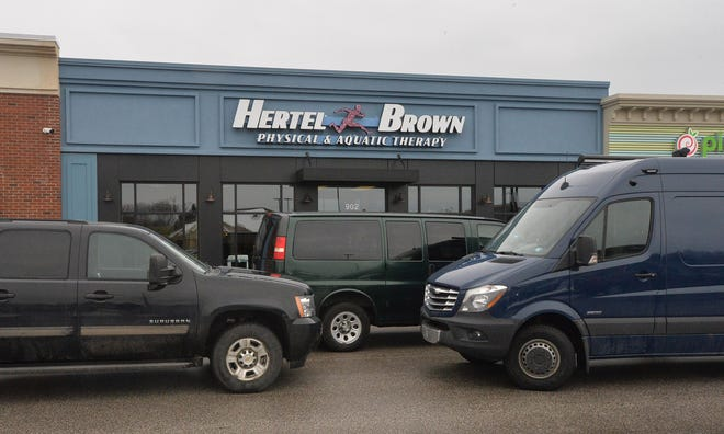 At least seven vans were parked outside a Hertel & Brown Physical & Aquatic Therapy at 902 W. Erie Plaza Dr. on Tuesday in Millcreek Township. The FBI and other agencies served federal search warrants at a number of locations for the Erie-based physical therapy business.