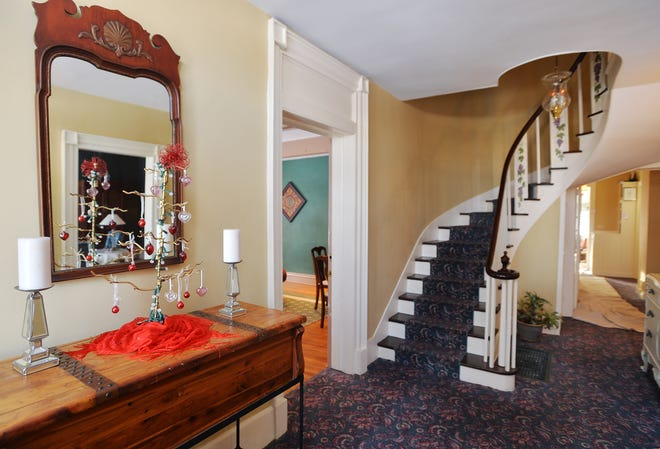 Inside the front entrance to one of two historic buildings that comprise the Grape Arbor Bed and Breakfast is shown in North East.