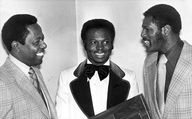 In this Jan. 28, 1975, file photo, three of the top players in baseball, from left, Hank Aaron, Lou Brock and Bob Gibson talk at an event where they were honored by St. Louis baseball writers in St. Louis. All three Hall of Fame players have passed away in recent months.