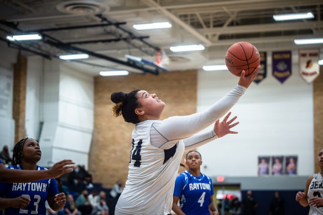 William Chrisman senior forward Jacque David (34) drives for a reverse layup in a game earlier this season. Chrisman has surged with a 14-game win streak since David returned from an ACL injury that wiped out much of her junior season.