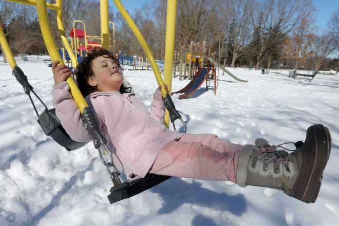 Eloise Yacko, 5, soaks up the sun Tuesday while swinging on playground equipment in Crapo Park. Eloise was at the park with her mother and a family friend enjoying the warm weather. Temperatures are forecasted to remain in the 40s through the week, possibly hitting 50 degrees by Saturday.   The Hawk Eye is accepting photo submissions from readers for a chance to be published in our quarterly Currents magazine through Friday. To submit your photos, email them, along with a caption, to news@thehawkeye.com.