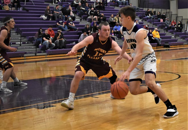 Keokuk's Anthony Potratz (right) heads toward the basket past Mount Pleasant's Chase Williamson in the first half of the Class 3A substate game at Keokuk Monday night. Mount Pleasant won, 50-46.