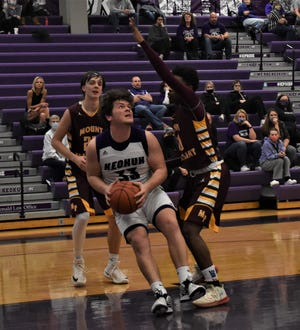 Keokuk's Callum Tackes (33) tries to drive to the basket but is stopped by Mount Pleasant's Dewan Trent in the first half of Monday's Class 3A substate game at Keokuk. Mount Pleasant won, 50-46.