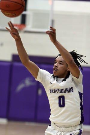 Burlington High School's Michael Alexander (0) shoots the ball during their Class 4A substate quarterfinal against Bettendorf, Monday Feb. 22, 2021 at Burlington's Carl Johannsen Gymnasium.