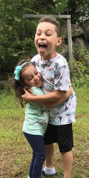 Dontae Butler, 10, of Dover, hugs his sister and best friend Sophia Dilone, 6. Following Dontae's death due to cancer, Dontae's family is sharing his story and the impact he had on others in the hopes of spreading more kindness and help to people who need it.