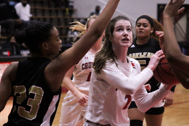 Bishop Kenny forward Clare Coyle (2) tries to get through Oakleaf defenders during a December game. Coyle and fellow freshman Sydney Roundtree have emerged as key contributors in the Crusaders' charge to the final four.