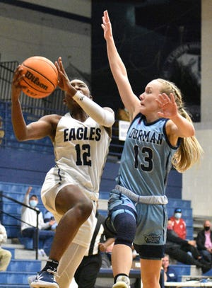 Clover's Aylesha Wade goes strong to the basketball as a Dorman player attempts to defend the shot during Monday's game in the S.C. state playoffs. [JOE L. HUGHES II/Gaston Gazette]
