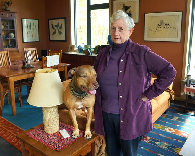 """Dr. Annetta Cheek, a founder of the plain language movement on Oct. 25, 2019, in Hume, Va. The Plain language is writing designed to ensure the reader understands as quickly, easily, and completely as possible. Plain language movement strives to make documents and forms to be easy to read, understand, and use. It avoids verbose, convoluted language and jargon. Cheek poses with one of her dogs, Keegan, which means """"small and fiery""""."""
