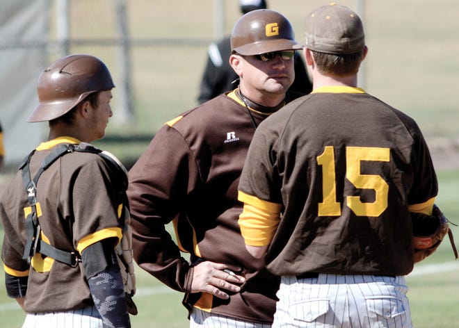 Garden City Community College Head Baseball Coach Chris Finnegan, center, talks with pitcher Noah Draper (15) and catcher Mason Brown (5) on the mound during a game last season at Williams Stadium.
