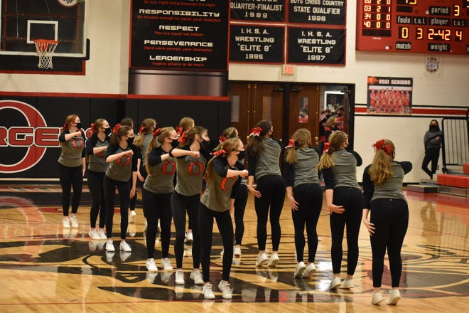Orion cheerleaders perform at halftime of the varsity boys basketball game with Rockridge on Friday, Feb. 19, in the Charger gym.