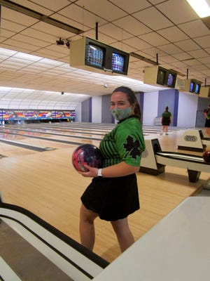 Miranda Roemer, a senior at Geneseo High School, gets ready to bowl with the GHS Girls' Bowling Team at Lee's Lanes in Geneseo.