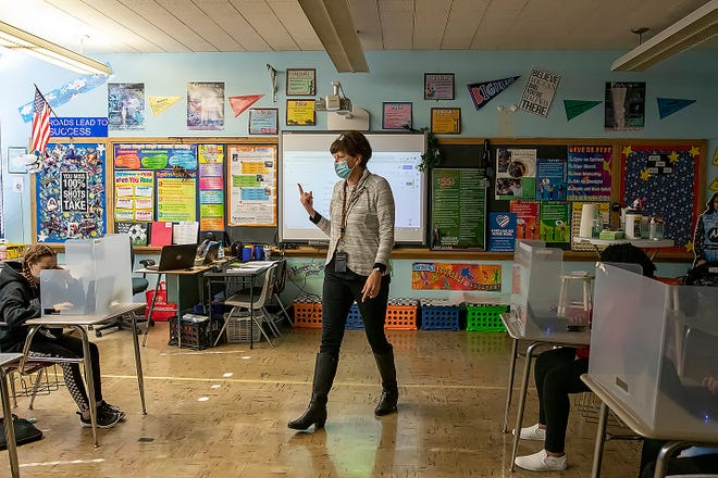 Churchill Junior High School teacher Teresa Powell talks to her seventh grade English class on Tuesday, Feb. 23, 2021.