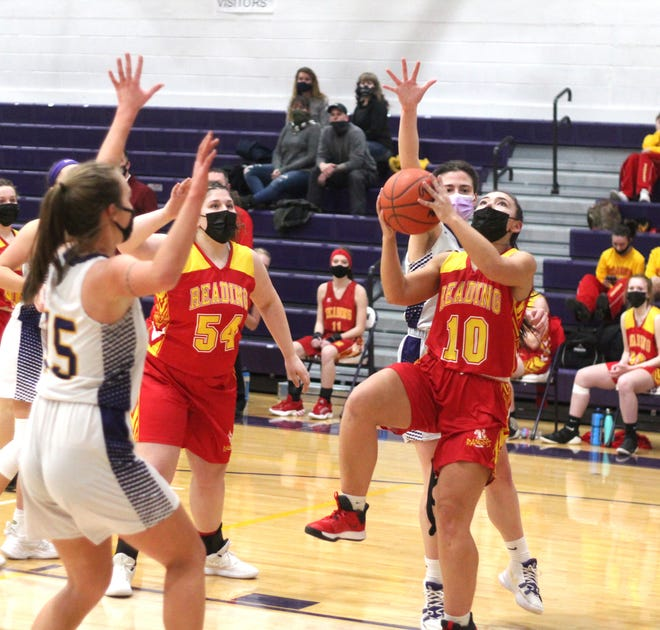 Reading's Lauren Dewey (10) takes the ball up strong in the paint for two points while teammate Ashlyn Tesch (54) looks on Monday night versus Bronson.
