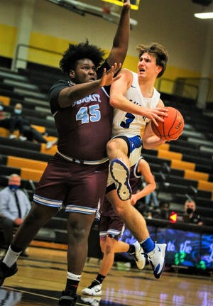 Van Alstyne's Blake Skipworth drives to the basket against Uplift Summit's Cameron Jamerson in a Class 4A Region II bi-district match-up.