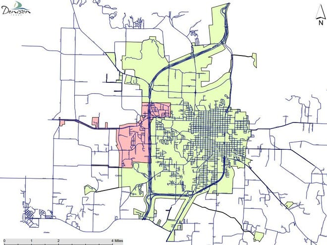 A map shows areas of Denison, highlighted in green or red, where a boil order has been lifted. Areas that are not highlighted remain under a boil order.