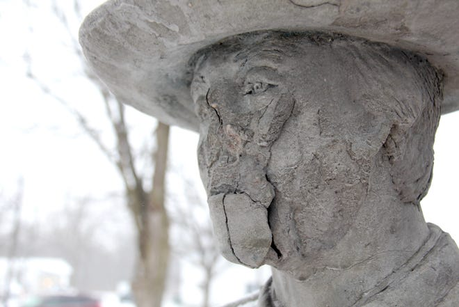 Damage is visible to a Confederate statue in the Allendale Garden of Honor in Allendale Township, Mich., Tuesday, Jan. 19, 2021.