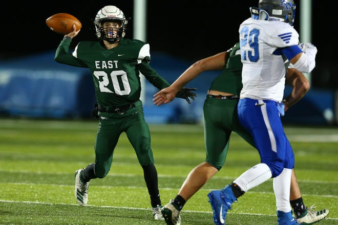 East Henderson's Tanner Allison passes the ball during the second quarter against Smoky Mountain last season at East.