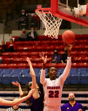 Nafatoumata Haidara shoots for the basket in the Blue Dragons' win over Dodge City Monday night.