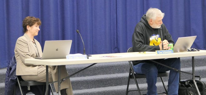 Nickerson superintendent Dawn Johnson and board president Dan Schweizer listen to a community member share his support for Johnson at the Nickerson-South Hutchinson School Board Meeting on Monday at Reno Valley Middle School in Hutchinson.