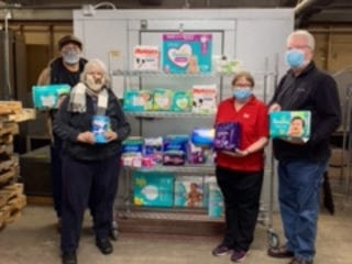 The Stephenson County Democrats are currently conducting a diaper and feminine hygiene products drive in coordination with the Freeport Salvation Army. Pictured, from left: Stephenson County Democrat Party Chairman Renardo Weathersby, Cindy Bielefeldt, Capt. Lisa Thorson and Capt. Tim Thorson.
