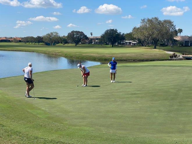Florida Southern's Loren Perez putts for birdie on her final hole, No. 18 at Grasslands.