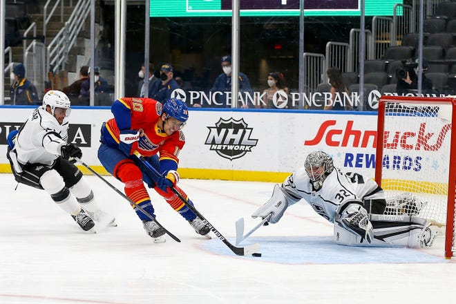 St. Louis Blues' Brayden Schenn (10) is unable to score as Los Angeles Kings' goaltender Jonathan Quick (32) and Anze Kopitar (11), of Slovenia, defend during the second period of an NHL hockey game Monday, Feb. 22, 2021, in St. Louis.