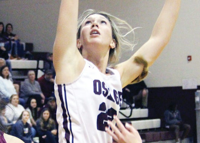 Osage senior Liberty Gamm launches a shot between Eldon defenders on Monday, February 22, in Osage Beach. Gamm led all scorers with 25 points.