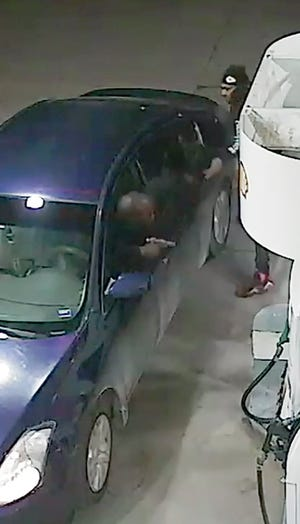Pictured are two men who allegedly fired shots at each other in the parking lot of a Leavenworth convenience store. Police are asking the public's help in identifying the men.