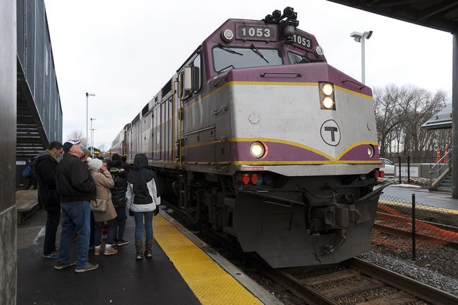 A commuter rail train makes a stop in Framingham inbound to South Station.
