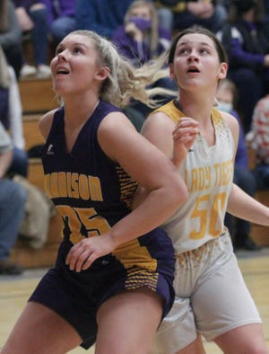 Rylee Thomas of Madison and Higbee's Kylleen Gibson (#50) both look for a rebound opportunity during Monday's Class 1 District 10 girls tournament game played at Higbee. The fourth-seed Lady Tigers held off Madison winning 44-36 and will battle No. 3 state-ranked Community of Laddonia in the 6 p.m. semifinal Wednesday.