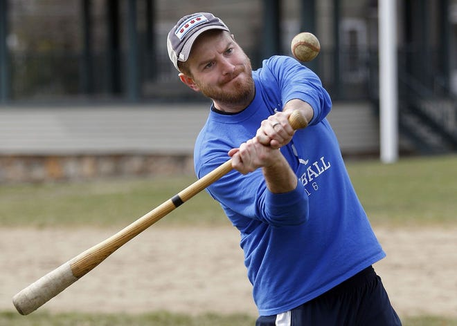 Hopedale baseball head coach Josh Crescenzi hits balls out to his players during practice in 2016. Crescenzi announced on Tuesday that he's stepping down as head coach.