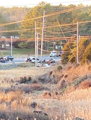 "This photo shows the crash scene after a pickup truck hit a TVA electrical transmission tower at the intersection of South Illinois Avenue/state Highway 62 and Union Valley Road on Friday, Jan. 22. In a note with several photos sent to the newspaper shortly before 11 p.m., Lisa Hoyt wrote: ""... My husband (Kevin Patrick Hoyt) is the Director at the UT Arboretum. We took these photos on the property. Our power just came back on around 20 minutes ago. We live in the house on the property. Much gratitude to all the workers, police officers, etc.!"""