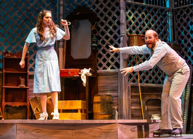 """Sally Talley, a farm girl from Missouri played by Katherine Stenzel, lets go of the hand of Matt Friedman, a Jewish accountant from St. Louis played by Alex Dagg, as he performs an old-fashioned skate with his girl on Monday during a dress rehearsal for the Ocala Civic Theatre's newest play, """"Talley's Folly,"""" which opens Thursday."""