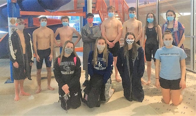 Members of the Oyster River High School boys and girls swim teams gather after they competed in their events as part of Sunday's Division II virtual championship meet. Pictured, front row, from left, Tess Pueshel, Elli Donovan, Libby Davidson and Addie Berglund. Pictured, back row, from left, Jonas Teeter, Theo Carlson,  William Carrico, Brenndan Teeter, Emerson Moore, Andrew Kelly, Laura Kelly, and Tessa Brown. Missing from photo, Jenna Parks.